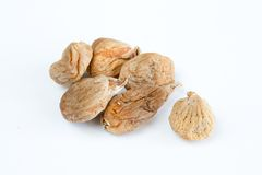 Dry organic figs. Few dry figs isolated on white background Royalty Free Stock Photos