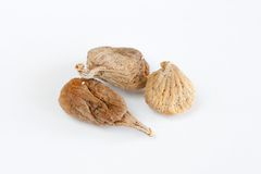 Dry organic figs. Few dry figs isolated on white background Royalty Free Stock Photography