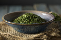 Dry Organic Green Parsley Flakes Royalty Free Stock Photos