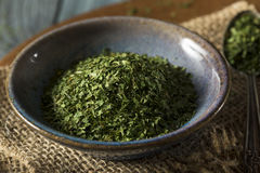 Dry Organic Green Parsley Flakes Stock Photos