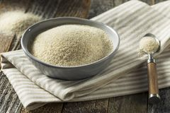 Dry Organic Ground Farina Wheat. In a Bowl Stock Photos
