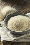 Dry Organic Ground Farina Wheat. In a Bowl Royalty Free Stock Photos