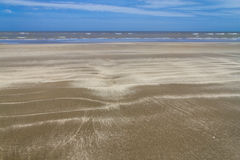 Dry over wet sand  and waves in Cassino beach Royalty Free Stock Photos