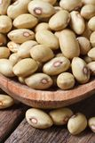 Dry pale yellow kidney beans macro in a spoon on table. Stock Images