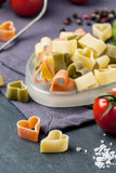 Dry pasta as hearts Stock Images