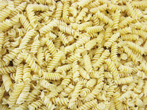 Dry pasta. Pasta background.. Scattered pasta. Macaroni. Food background. Natural background Royalty Free Stock Images