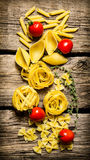 Dry pasta with cherry tomatoes and herb. Royalty Free Stock Photo