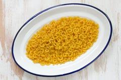 Dry pasta on dish Stock Image