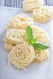 Dry pasta with fresh basil Stock Photos