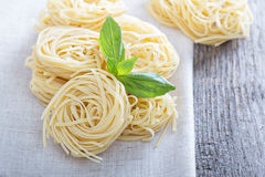 Dry pasta with fresh basil Royalty Free Stock Photography