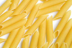 Dry pasta penne background Royalty Free Stock Photos