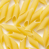 Dry pasta penne background Stock Photography