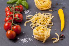 Dry pasta with tomatoes, basil and pepper Stock Photography