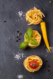 Dry pasta with tomatoes, basil and pepper Stock Image