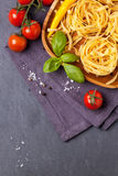 Dry pasta with tomatoes Royalty Free Stock Image
