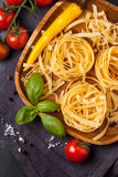 Dry pasta with tomatoes Royalty Free Stock Photography