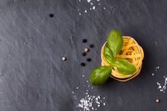 Dry Pasta With Basil Stock Photos