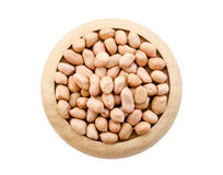 Dry peanut seeds in wooden dish. Royalty Free Stock Image