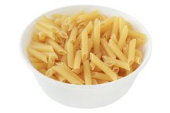 Dry penne in a bowl Royalty Free Stock Photos
