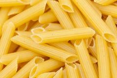 Dry Penne Regata Pasta. Uncooked dry penne regata italian pasta Stock Photo