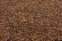 Dry pet food (dog or cat) brown background Royalty Free Stock Photo