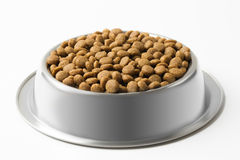 Dry pet food in a metal bowl isolated on white background Stock Images