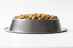 Dry pet food in a metal bowl isolated on white background Stock Photos