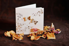 Dry petals roses and greeting card Stock Images