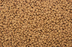Dry pets food background Stock Photo