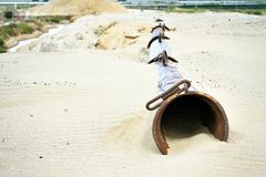 The dry pipe of the dredger lies on the sand in the sand quarry Stock Photography