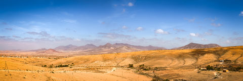 Dry plains with mountains in the distance. Dry plains with some small villages and mountains in the distance Stock Image