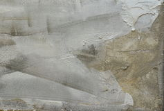 Dry plastering on wall. Grey background for masonry theme. Royalty Free Stock Photography