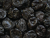 Dry plums or prunes fruit as background Stock Photos