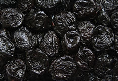 Dry plums or prunes fruit as background Royalty Free Stock Images