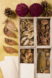 Dry potpourri in boxes. On a wooden background stock photo
