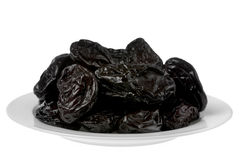 Dry prune. Fruit in white plate detail Stock Image