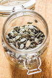Dry pumpkin seeds in a glass jar Stock Photography