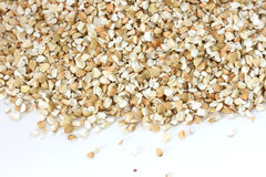 Dry raw buckwheat on white background Royalty Free Stock Images