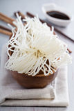 Dry raw rice noodle in a bowl. Dry raw rice noodle in a wooden bowl stock photo