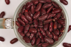 Dry red beans in a glass mug. Healthy food rich in vegetable protein. Nutritionists around the world recommend eating dishes of wild red rice Royalty Free Stock Photography