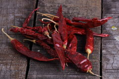 Dry red chillies. Dry chili peppers are placed on old wood Stock Photos