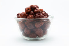 Dry red chines Jujube fruit in glass bowl Royalty Free Stock Images