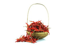Dry red pepper. With bamboo basket on white background Royalty Free Stock Photo