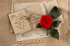 Dry red rose and old love letters Royalty Free Stock Images