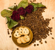 Dry red roses and cookies on coffee seeds Stock Images