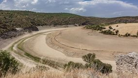 Dry reservoir. Top view of dry reservoir basin Stock Photo