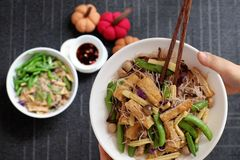 Dry rice vermicelli fried with vegetable stock photo