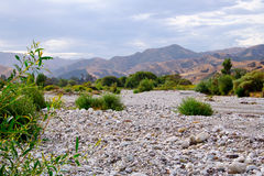 Dry river bed. Many New Zealand rivers fill quickly after the rain and empty quickly once it is over and spend most of their time fairly empty.  This is a Royalty Free Stock Photography