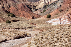Dry river bed with mountains in the Ounila Valley. Royalty Free Stock Photography
