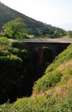 Dry River bed under ached bridge. Arched bridge over the dry river bed connect the town of Ribeira Filipe to Campana Riba on the island of Fogo, Cabo Verde Royalty Free Stock Photography